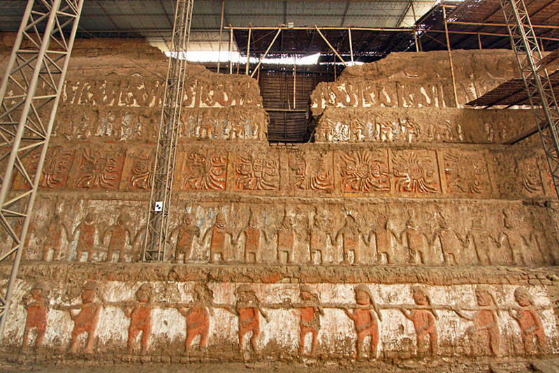 Immense wall of painted carvings from Moche culture at Huaca de Moche Museum, Trujillo, Peru