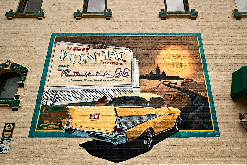 Mural on the side of a building in Pontiac, Illinois celebrates the golden age of automobiles, as well as historic U.S. Route 66