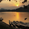 Boats on the Mekong River tied up for the night in Luang Prabang, Laos