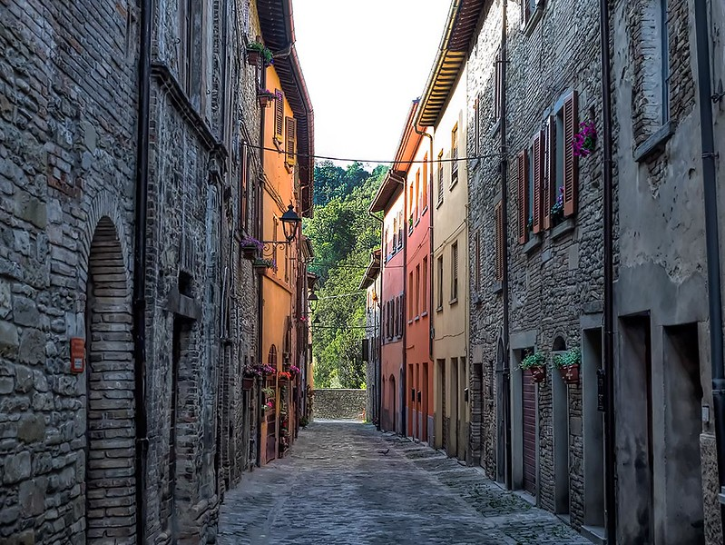 Ancient stone buildings mingle with brightly painted facades in the village of Mercatello sul Metauro in the Le Marche province of Italy