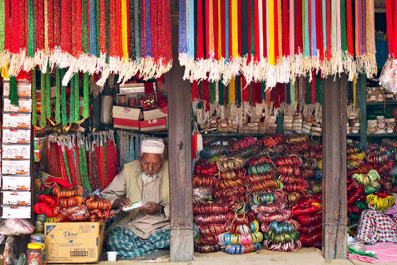 Vendor sells bracelets in Patan's Durbar Square, Nepal