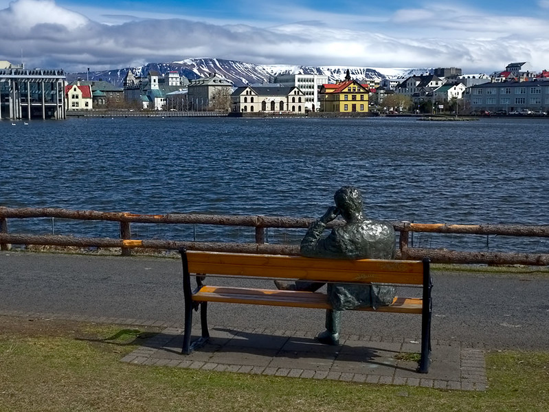 Bronze man enjoys view across the Pond in Reykjavik, Iceland