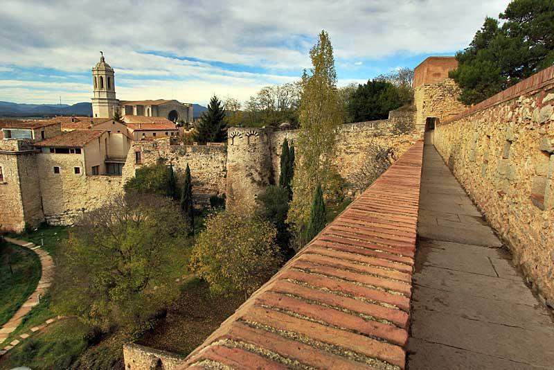Walking along the top of the Muralla, the old Roman wall in Girona, Spain