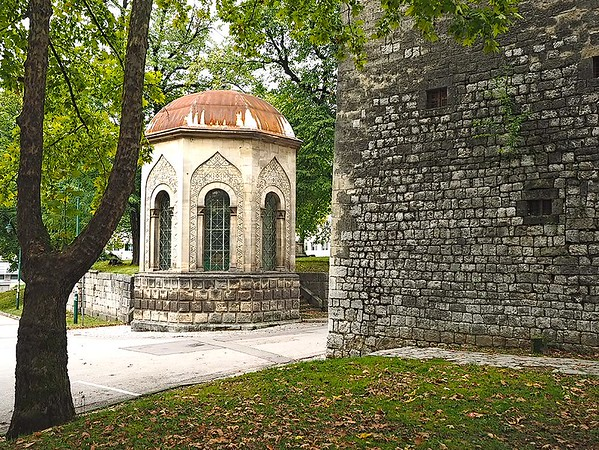 "Two of the most interesting structures in Bihac, Bosnia-Herzegovina: an uncommon octagonal style ""Turbe"" (Ottoman mausoleum) and the square Captain's Tower, which is one of the oldest buildings in town and today houses the Regional Museum."