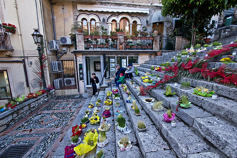 Flowers and ribbons are lovingly arranged on steps in Taormina, Sicily, Italy