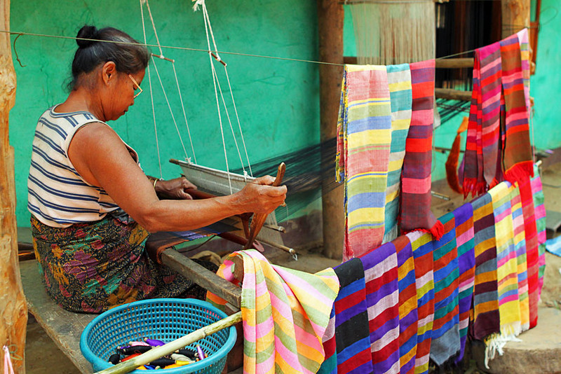 Traditional shawls are hand-loomed by hill tribes of northern Laos