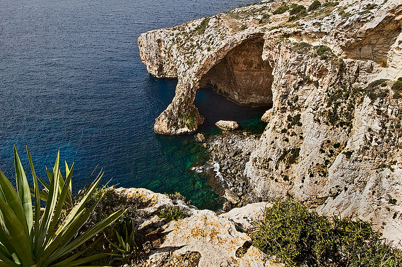 Entrance to the Blue Grotto on the island of Malta, which leads to a honeycomb of caves in the limestone cliffs