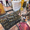 Visitors to Doi Suthep Temple in Chiang Mai press coins into this panel to earn merit