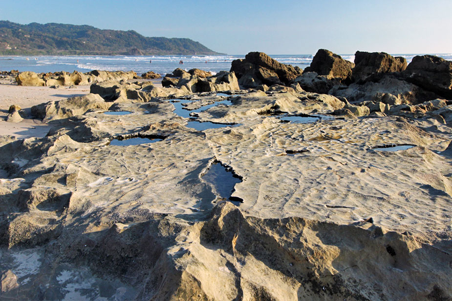 Volcanic outcroppings, Playa del Carmen beach on the Nicoya Peninsula of Costa Rica