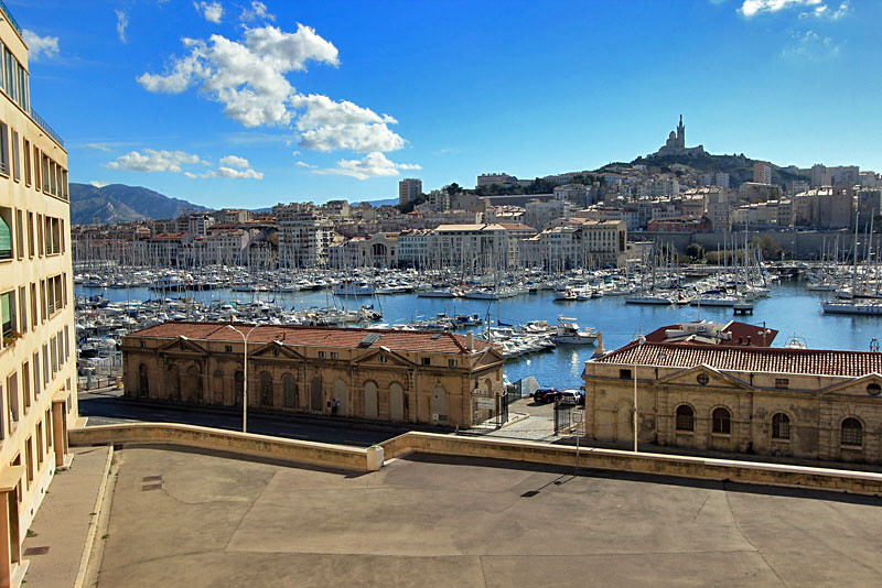 Vieux Port, with Notre Dame de la Garde Cathedral atop hill, Marseille, France