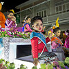 Thai girls wave from a float in the annual Yee Ping and Loi Kratong festival in Chiang Mai, Thailand
