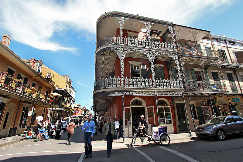 Iconic building in the French Quarter of New Orleans, features galleries surrounded by elaborate ironwork
