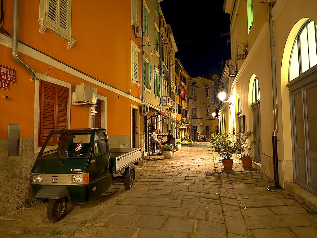 Cobblestone streets of Piran, Slovenia by night. The lanes are so narrow that special mini trucks are employed to move goods around and collect the trash.