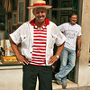 Gondolier in Venice strikes a pose for the camera