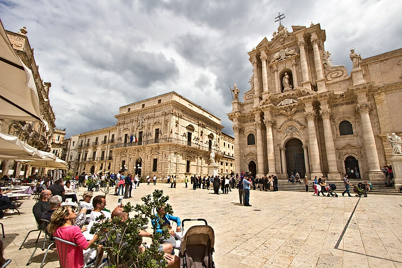 Piazza Duomo, the beautiful baroque square in the center of the island of Ortigia (the Old Town), in Syracuse, Sicily. Seen here is the Duomo (Cathedral) on the right, and City Hall on the left.