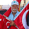 Vendor proudly peddles Turkish flags in the square of the New Mosque in Istanbul