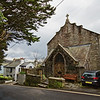 Pretty churches and cottages line the hilly streets of St. Mawes in Cornwall, England