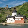 In the MittelRhein area of Germany, the hilltop Gutenfels castle overlooks Pfalzgrafenstein Castle, perched on a rock in the middle of the Rhine River