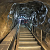 Long shaft and stairway leads down into the bowels of the Salina Turda Salt Mine in Turda, Romania