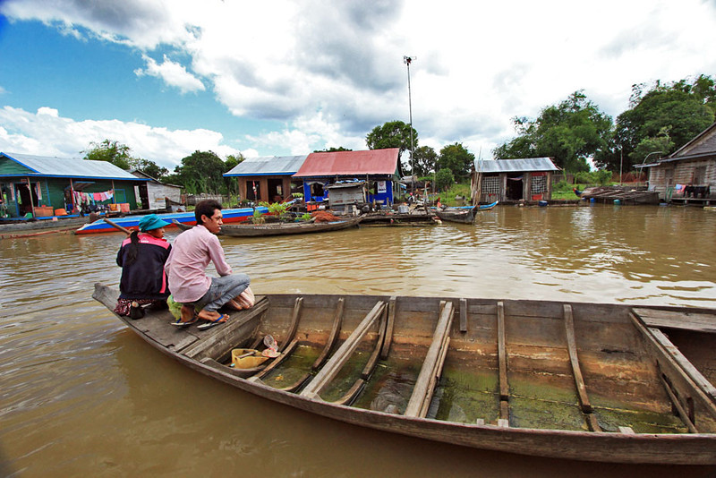 Floating houses on Tonle Sap River on ride to Siem Reap