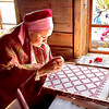 Woman creates traditional embroidered linens on Kizhi Island, Lake Onega, Russia