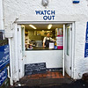 Tiny take-away window in the center of Saint Mawes offers fish and chips in Cornwall, England