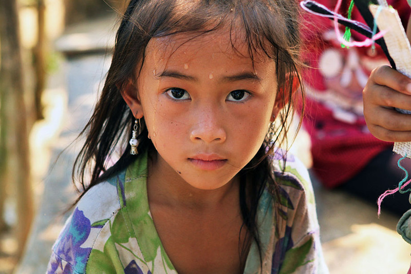 Hill tribe girl in a tiny village on the shores of the Mekong River, Laos