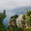 Rugged coastline emerges from the mists during a drive along Italy's famous Amalfi coast, between Sorrento and Positano