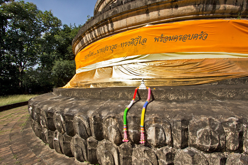 Base of the giant chedi at Wat Umong, a forest tradition temple in Chiang Mai, Thailand
