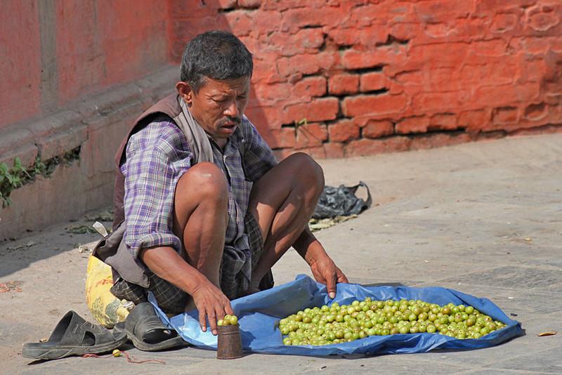 Vendor Offers His Wares in Durbar Square, Kathmandu, Nepal