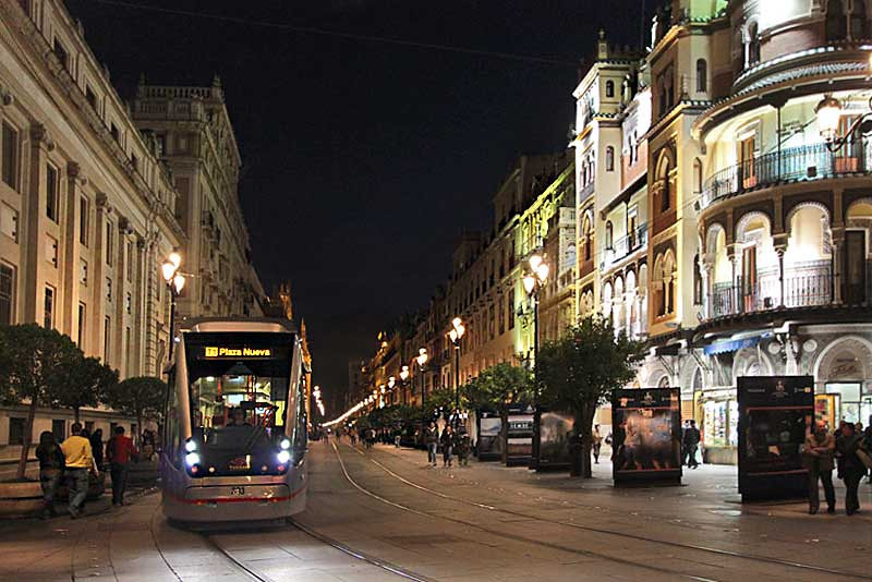 Tram carries tourists through the center of Seville, past many of the city's main sights