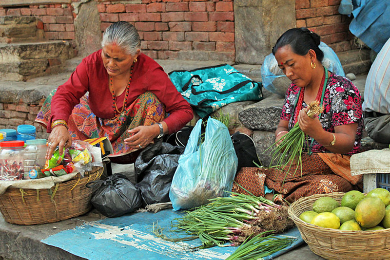 Women prepare their produce for the day's customers in Durbar Square, Kathmandu, Nepal
