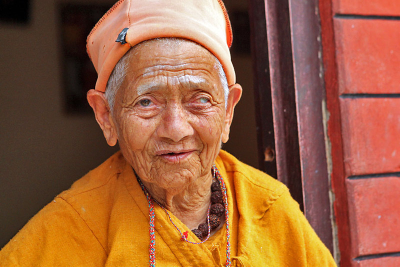 Resident of the Pokhara Aged Center happily greets visitors