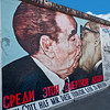 Famous painting on East Side Gallery of Berlin Wall, depicting East German President Erich Honnecker and Leonid Brezhnev kissing