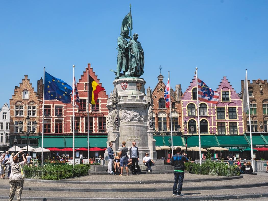 Market Square in Bruges, Belgium, with statue of Jan Breydel and Pieter De Coninck in front of old Guild Houses