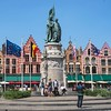 Market Square in Bruges, Belgium, with statue of Jan Breydel and Pieter De Coninck in front of old Guild Houses