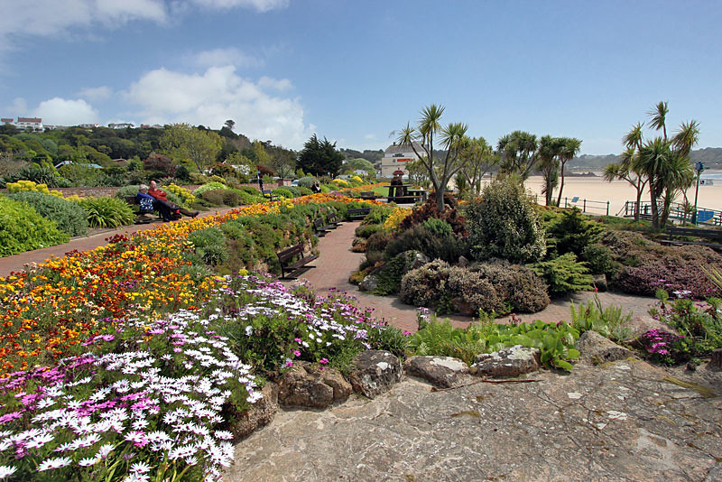 St. Brelades' Bay, lovely seaside gardens frame a popular beach on the British Isle of Jersey