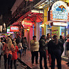 Revelers on Bourbon Street in the French Quarter of New Orleans
