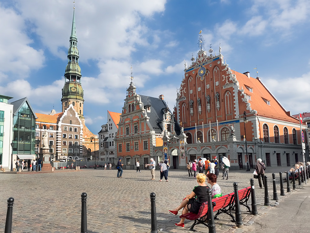 Town Hall Square in Riga, Latvia, with House of the Blackheads Guild Hall. Saint Peter's Church soars in the background.