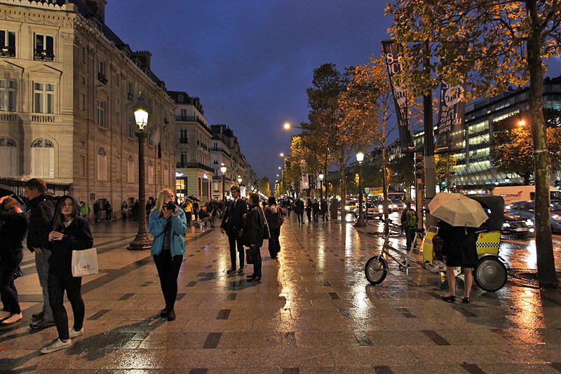 Rainy night on the Champs Elysee, Paris, France
