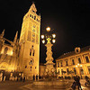 Giralda, the bell tower of the Cathedral of Seville, dominates the central plaza in Seville, Spain