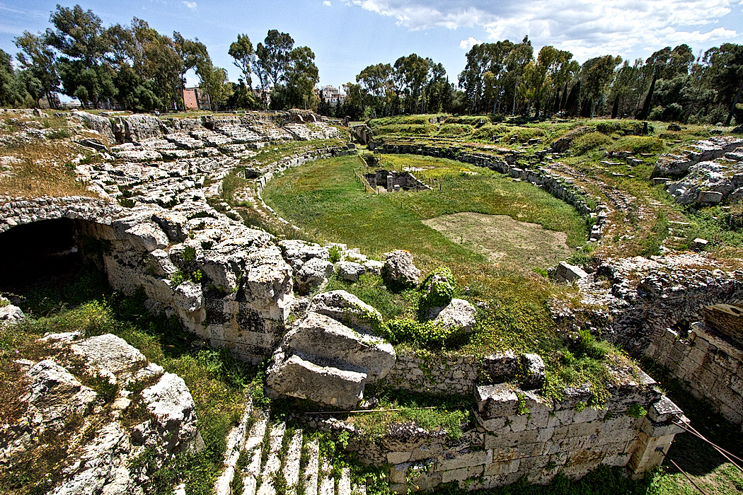 The Roman Amphitheater in Syracuse, Sicily, built in the 3rd-4th century A.D., was used for gladiator and animal fights.