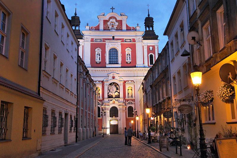 Cobblestone street leads to Parish Church of St. Stanislaus in Poznan, Poland