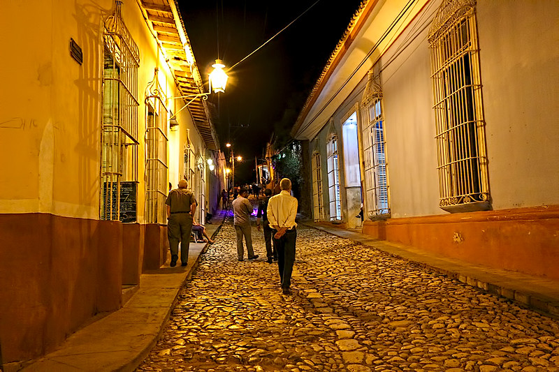 In the evening, golden light washes over the restored colonial homes and cobblestone streets of Trinidad, Cuba