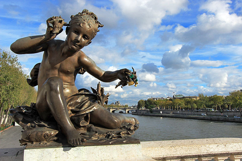Love locks on sculpture on Alexandre III Bridge in Paris, France