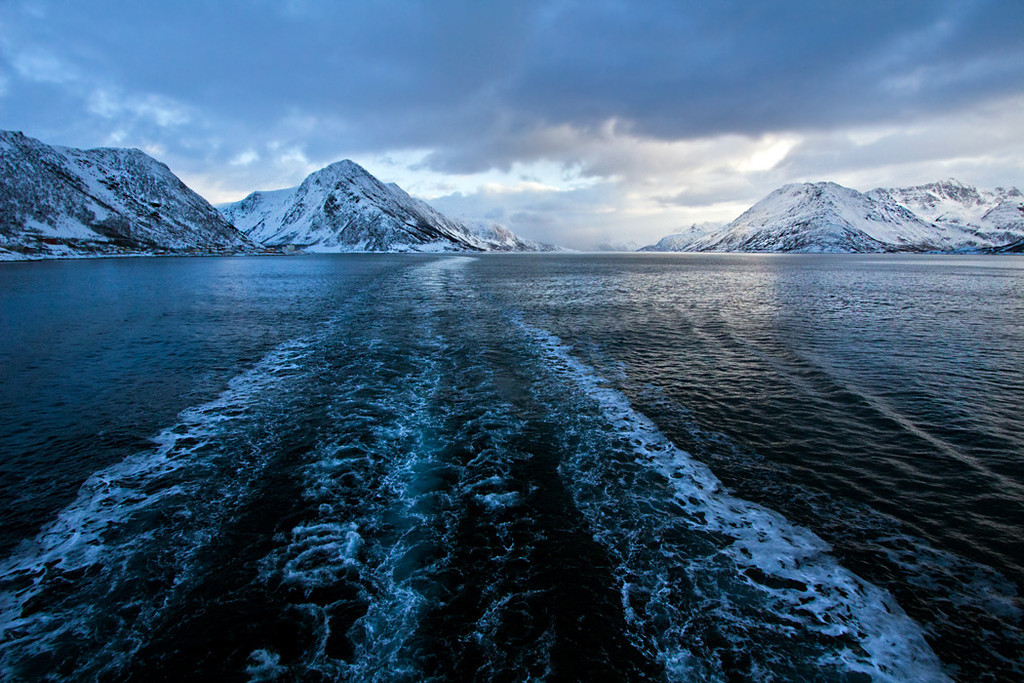 View from the aft of Hurtigruten's MS Richard With, sailing between Oksfjord and Skjervoy, Norway