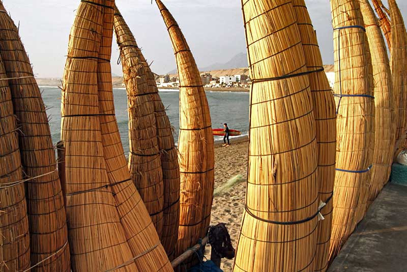 Reed boats line the shore in Huanchaco, Peru, just north of Trujillo