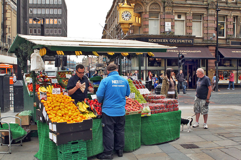 Fruit seller on the streets of downtown Newcastle, England