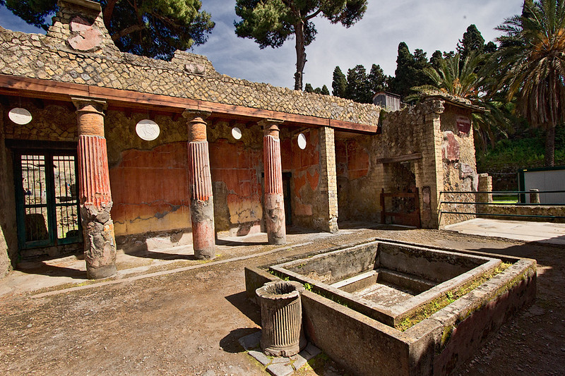 Discs hanging between pillars ward off evil at House of the Relief of Telephus in Herculaneum
