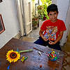 Young artist models in Play-Doh at Trazos Libres community art project in Cienfuegos, Cuba,